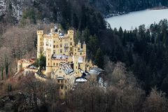 SCHWANGAU, GERMANY - DECEMBER 2018: Winter view over Hohenschwangau Castle. Close to Bavarian town of Fussen royalty free stock image
