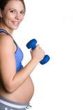 Schwangere Eignung-Frau stockfoto