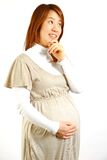 Schwangere Frau denkt an something  Lizenzfreies Stockfoto