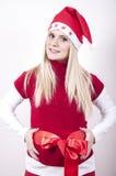 Schwangere Frau der Panik mit Weihnachtshut Lizenzfreie Stockfotografie