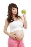Schwangere Frau, die gesunde Nahrung isst Stockbilder