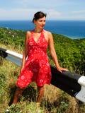 Schwangere Frau im roten Kleid Lizenzfreie Stockbilder