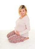 Schwangere Frau lokalisiert lizenzfreie stockfotografie