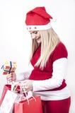 Schwangere Frau mit dem Weihnachtseinkaufen Lizenzfreies Stockfoto
