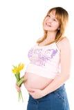 Schwangere Frau mit gelben Tulpen lizenzfreie stockbilder