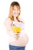 Schwangere Frau mit gelben Tulpen lizenzfreie stockfotografie