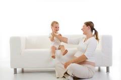 Schwangere Frau mit Kind Stockbilder