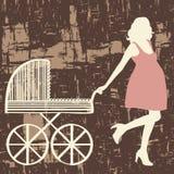 Schwangere Frau mit Wagen. Stockbilder