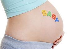 Schwangere Frau - SCHÄTZCHEN Stockbild