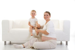 Schwangere Frau und Kind Stockfotografie