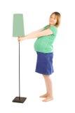 Schwangere Frau und Lampe lizenzfreie stockfotografie