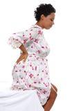 Schwangere Frau, welche die rückseitigen Schmerz hebt Lizenzfreie Stockbilder