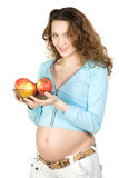 Schwangere Frauen mit Äpfeln Stockfoto