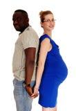Schwangere Paare zurück zu Rückseite Stockfotografie