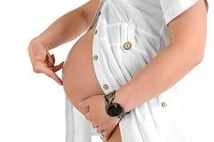 Schwangerer Bauch mit den gehenden Fingern Stockbilder