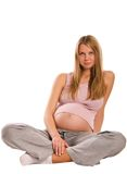 Schwangeres blondes Mädchen auf weißem Hintergrund Stockfotos