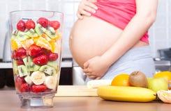 Schwangerschaft und Nahrung Stockbild
