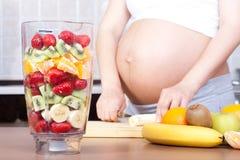 Schwangerschaft und Nahrung Stockfotos