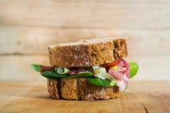 Schwartzwald sandwich. Sandwich with schwartzwald ham, onion, tomato and baby spinach Royalty Free Stock Image