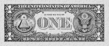 Schwarz-weiße Dollarbanknote auf einer Steinwand Stockfotos