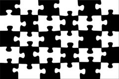 Schwarz-weißes Schachpuzzlespiel des Hintergrundes. Stockfotografie