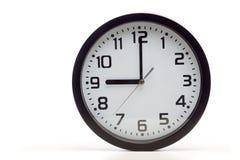 Schwarze analoge Uhr Stockfotografie