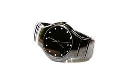 Schwarze Armbanduhr lizenzfreie stockbilder