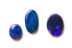 Schwarze australische Opale Stockbilder