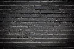Schwarze Backsteinmauer Stockfotografie