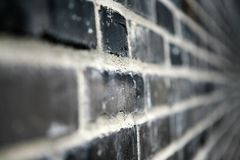 Schwarze Backsteinmauer lizenzfreie stockfotos