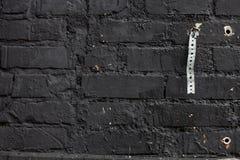 Schwarze Backsteinmauer Stockbilder