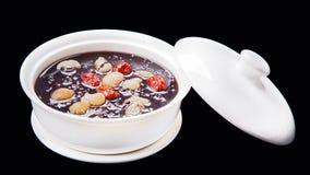 Schwarze Bonbonsuppe des klebrigen Reises Chinesisches traditionelles Küche isolat Stockfotografie