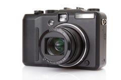 Schwarze digitale kompakte Kamera Lizenzfreie Stockfotos