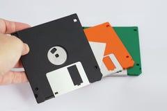 Schwarze Diskette wird gewählt Stockbild