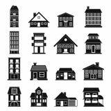 Schwarze einfache Ikonen der Häuser eingestellt Lizenzfreie Stockfotos