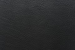 Schwarze Farbkörnige, starke Kornkalbkuhlederbeschaffenheit und Hintergrund lizenzfreie stockbilder