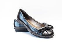 Schwarze flache Schuhe Lizenzfreie Stockfotografie