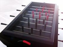 Schwarze foosball Tabelle mit Blendenfleck Lizenzfreie Stockfotografie