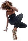 Schwarze Frau mit den langen Fahrwerkbeinen Lizenzfreie Stockfotografie