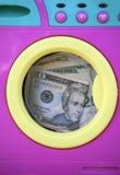 Schwarze Gelddollarreinigungsmetapher stockbild