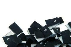 Schwarze Gewebekleidergrößeaufkleber Stockfoto