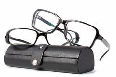 Schwarze Gläser mit Fall Lizenzfreie Stockbilder