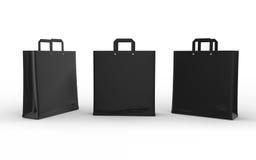 Schwarze Glanzpapiertasche lokalisiert auf Weiß mit Beschneidungspfad Stockfotografie