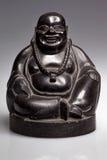 Schwarze hölzerne Statue Buddha Lizenzfreie Stockfotografie