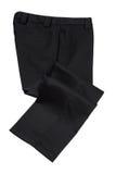 Schwarze Hosen, Hose auf weißem Hintergrund Lizenzfreie Stockfotos