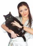 Schwarze Katze und Tierarzt Stockfotos