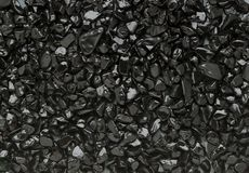 Schwarze kleine Steine Stockfotos