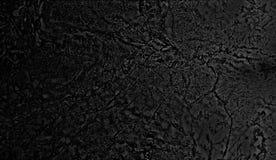 Schwarze konkrete Steinoberflächenbeschaffenheit oder Hintergrund Stockfoto