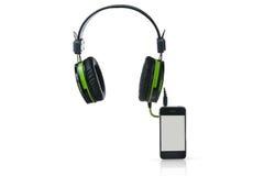 Schwarze Kopfhörer und intelligentes Telefon Lizenzfreie Stockfotos