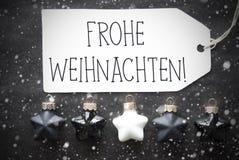 Schwarze Kugeln, Schneeflocken, Frohe Weihnachten bedeutet frohe Weihnachten Lizenzfreie Stockfotos